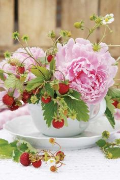 Peonies and wild strawberries.a gorgeous arrangement