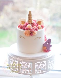 Tall unicorn birthday cake for little girl. Gold, peach and pink