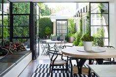 dining room to patio, Inside/outdoor living, black frame windows, design by Wonder