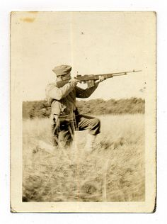 U.S. soldier firing what seem to be a M1918 Browning Automatic Rifle.