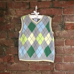 Baby Gap Argyle Vest for Boys. Adorable v neck Baby Gap Argyle Vest for Boys. Colors include gray, yellow, lime green, grass green, light blue and blue. Perfect for Easter size 3 toddler Baby Gap Sweaters V-Necks