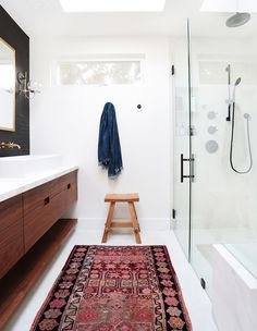 Matte black fixtures pick up on the deeper tones of the rug in this modern bathroom. | Photographer: Tessa Neustadt | Designer: Amber Interiors