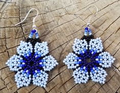 These are some Blue Beaded Floral Flower Petal Earrings. I used glass seed beads and tediously put them together by hand. Love the way these turned out, looking way cuter then I imagine. The colors I used for these earrings are Blue, Really Dark Blue, Dark Blue, Light Blue, Really Light Blue and Black. Can easily be the perfect gift for that special someone of yours. Just got to love these, very cute and simple...  Measurements. Length:1.3/4 Flower Width:1.1/2  Please also note that...