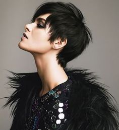 More black than brunette, this edgy cut suits the models pale skin without washing her out. It's important to choose hair shades that suit your skin tone! #hair