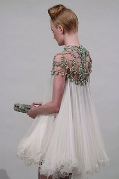 Marchesa - Classic Avant Garde!!  Saw the retail version of this at TARGET in Scottsdale! It was $100! Can u believe that?! It was a part of their Neman Marcus collection. Buy it while u still can!