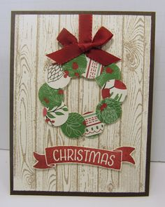 Paper scraps from This is Christmas DSP to make a wreath.  Hardwood background stamp.