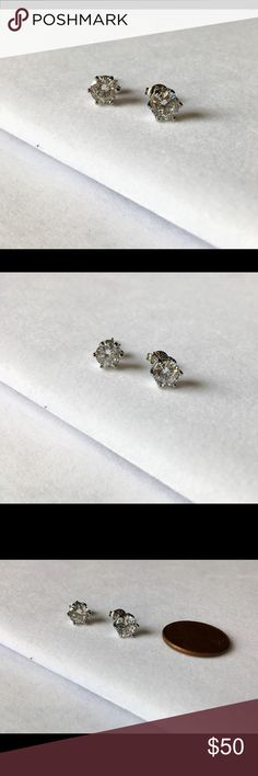 Swarovski Stud Earring Condition is new. Never been wore. Each earring is estimate 1 ct size. Marking silver is 925. Hypoallergenic. Swarovski Jewelry Earrings
