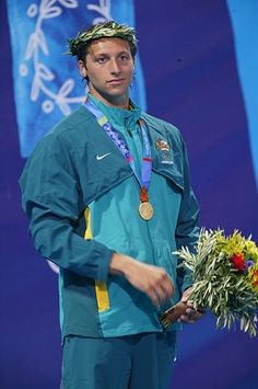 Australia's Ian Thorpe, Athens, 2004  Why is this so camp? Is it the Grecian good looks of Australia's champ freestyle swimmer Ian Thorpe? Or is it the fact that he's wearing top-to-toe turquoise 'n' teal with a yellow contrast trim and a cropped bolero detail (does that part zip off or is it just for show? Hoping for the former and that it is lined with Gore-Tex.) The enormous gold medallion, sorry, medal pulls the whole thing together nicely. Or something