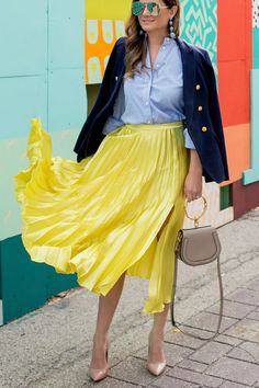 Jennifer Lake Style Charade in a yellow satin pleated skirt, navy blazer, Chloe Nile Bracelet bag, and Steve Madden pumps at a colorful mural in Chicago Yellow Pleated Skirt, Satin Pleated Skirt, Pleated Skirt Outfit, Skirt Outfits, Dress Skirt, Cute Outfits, Work Outfits, Summer Outfits, Pleaded Skirt
