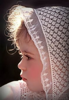 Beautiful child in antique lace baby bonnet ca.