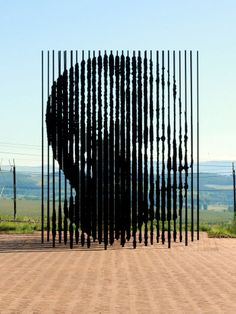 When the steel columns align they reveal the face of Nelson Mandela. Sculpture Art, Sculptures, Steel Columns, Nelson Mandela, Street Artists, Public Art, Change The World, Architecture Art, South Africa