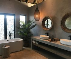 Incorporate Natural And Organic Elements Into Your Design Space. In This Cocoa Bean Project, We Created A Natural Space Using Raw Elements Of Wood As Well As Greenery. Keeping The Bathroom Neutral Colours Made These Design Natural Elements Pop.  #CocoaBeanInteriorDesign #cocoabean  #interiordesign #designideas #interiordesignideas #design #bushlodge #lodgedesign #africanvilla #designerhospitality