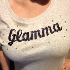 Grey Glamma T-Shirt Adorable grey Glamma T-Shirt. Original design and handmade. Black glitter over letters and surrounded by gems. Sizes XS-3X. Perfect for yourself or as a gift. To find more Pillows, clothes, signs, and vintage finds. Check out www.junkinloveco.com Tops Tees - Short Sleeve