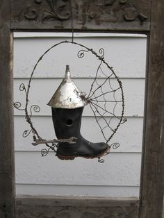 Picture only, but how great is this... unusual Rustic Rubber Boot Bird House with Barbed Wire