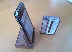 An old plastic cassette holder turned into an iphone (smartphone) holder.