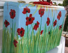 Paint and Mod Podge tissue paper on suitcase. Too cute!