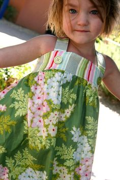 Sundress, I am going to make some of these for our Bella. :-)  Oh yeah break out the Sewing Machine!