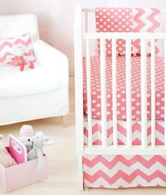 pretty pink nursery. loving the chevron and polka dots!