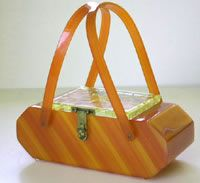 The Bakelite Handbag (not cheap or easy to find) but a cool addition.