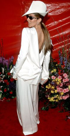 Outrageous Oscars Looks - RED CARPET - Celine Dion, 1999 from.  Her suit worn backward made a lot of noise.