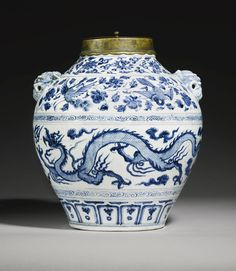 A MAGNIFICENT AND RARE BLUE AND WHITE 'DRAGON AND PHOENIX' JAR, YUAN DYNASTY