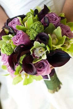 purple calla lilies, orchids, and roses