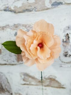 Peach paper flower with a bead center