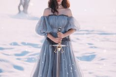 Warlike Girl With Dark Hair In Long Gray Vintage Light Dress, Lady Of Cold And Frost, Bare Open Shoulders And Sharp Stock Image - Image of forest, gray: 142255387 Dark Hair, Blue Hair, Norse Goddess, Norse Mythology, Goddess Dress, Light Dress, White Aesthetic, Queen Aesthetic, Book Aesthetic