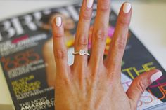 I adore this. SO classy, simple, realistic, and most likely a higher quality diamond. Just make it round ;)