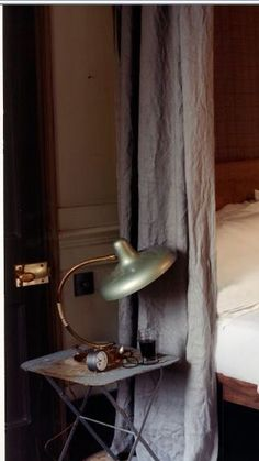 lights out | linen bed curtains | vintage bedside table and antique brass table lamp | white bedlinen | Get the look with Brera Lino Designers Guild Graphite Grey linen curtains from Bemz