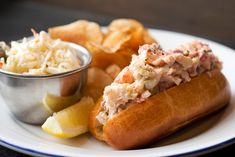This is a fairly classic mayo-accented lobster roll with a double dose of celery (diced fresh and in celery salt form), plus diced pickles mixed in for piquant...