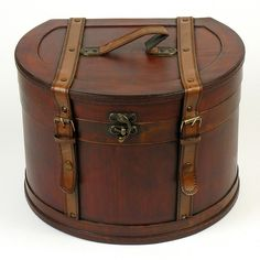 This stylish extra large wooden hat box is reminiscent of a bygone era. Around the rim is a lovely wave-like pattern. The...