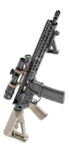 A Noveske NSR rail, Magpul furniture, Mega Arms upper and lower receiver, and Battle Arms Development selectors. The optics are Trijicon RMR and Accupoint in a Team Warne mount. Stickman of course.