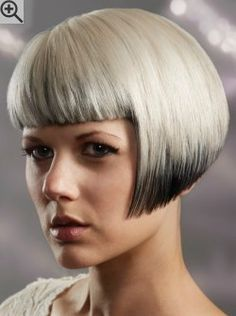 Short bob, cut in a shallow angled A-line and with straight bangs. Two tone hair coloring.