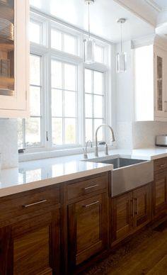 dark wood lower cabinets, white countertop