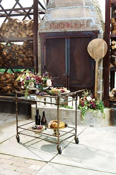 everything about this reminds me of your wedding.. a combination or earthy wood, industrial metal, shiny and vintage metallic pieces, purples of all variations, deep and bright greens, soft creams with a hint of pink, plums/figs/berries, candles and yummy food!