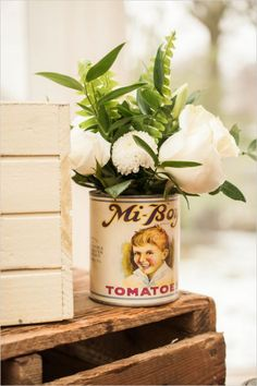 vintage can with florals #vintage #diy #weddingchicks http://www.weddingchicks.com/2014/03/06/julia-child-inspired-bridal-shower/