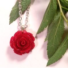 This piece is our vivid red rose necklace, made out of epoxy resin. We wanted to make the rose as realistic and polished as possible.