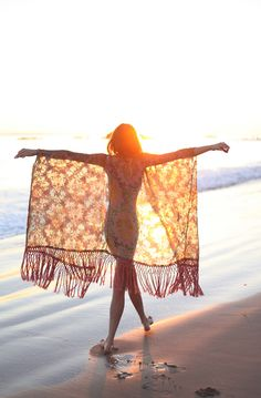 Easy DIY Beach Cover Up - take a light wrap or wide scarf and snip a hole in the middle for your head.  If you can sew, clean up the hole with a clean, light stitch.  Wear like a poncho