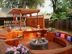 What better way to enjoy the outdoors these long summer days! #hunkeconstruction #outdoors #dreamspace #summerfun #deck #design #firepit #hottub