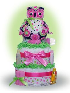 "Our Lil' Owl 2 tier diaper cake is bright and cheery with colors to match the plush owl toy. Give a ""hoot-out"" this year as the owl is becoming one of the most popular nursery themes. Only $66.00"