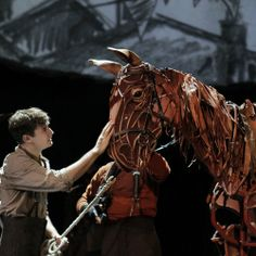 Seth Numrich in a scene from the National Theatre production of War Horse at Lincoln Center, based on the novel by Michael Morpurgo, adapted by Nick Stafford with the Handspring Puppet Co., directed by Marianne Elliott and Tom Morris.
