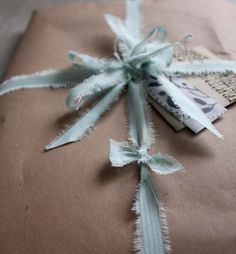 #packing and #wrapping: ribbon from torn-and-tied old silk fabric