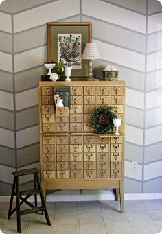 Love the herringbone wall and really love the old library card catalog drawers...I want one!