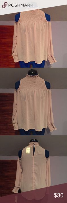 """Living Doll Light Mauve Cold Shoulder Top A top that buttons on the top back of the collar. Foley and good for summer or spring weather. Brand new with tag. No flaws identified. Mannequin is 5'4"""" and measures 33-26-36. Feel free to ask questions. Reasonable offers considered. No trades. Living Doll Tops Blouses"""