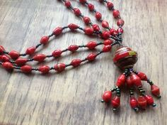 £13.00 Recycled Magazine Paper Beads Pendant, Red - handmade in Kenya.