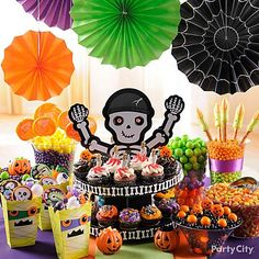 Sweet Halloween party food ideas displayed on a table full of friendly faces – perfect for a kids party!