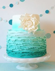 Ashlee's second cake choice if the first is not available. Ashlee wants Tiffany turquoise wedding theme ombre wedding cake but with dark pink flower instead of white like this. Add silver or bling either on the flower or cake topper bling Teal Cake, Blue Cakes, Turquoise Cake, Turquoise Wedding Cakes, Zebra Cakes, Color Cake, Turquoise Weddings, Pretty Cakes, Beautiful Cakes