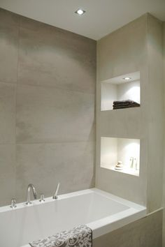 I wonder if these nooks could be lit in a shower as well. What a great focal point.