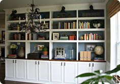 DIY built in bookcases with cabinet bases..info on how to build the bookcase and then decorate it.